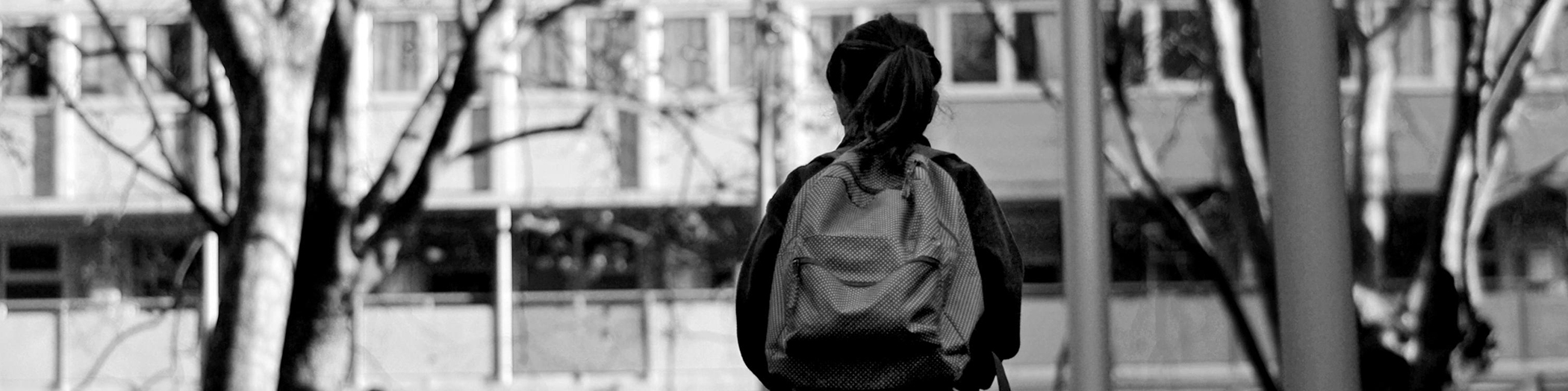 Black and white girl with backpack